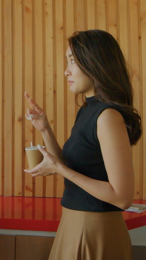Woman Holding Coffee
