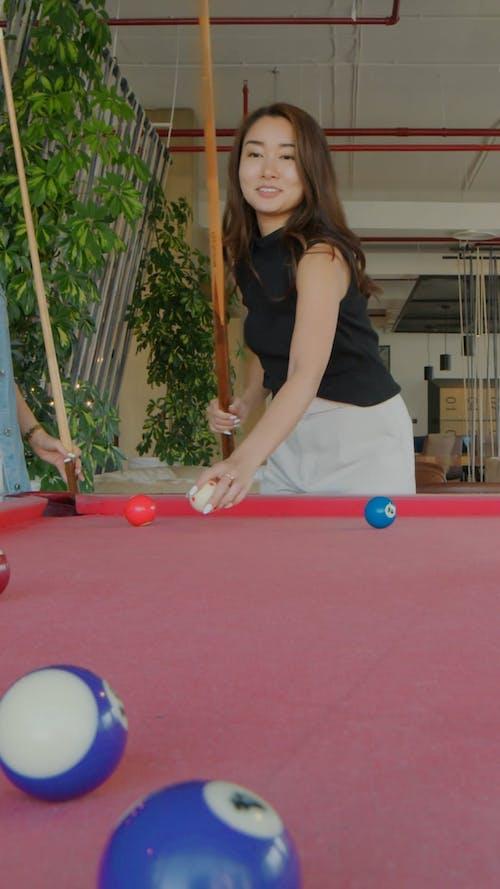 Women Playing Billiard