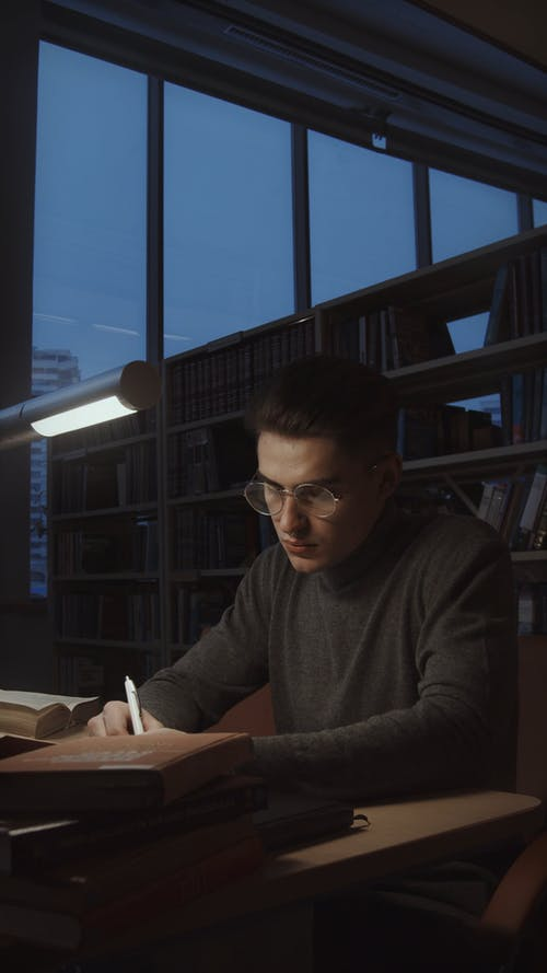 A Man Researching in a Library