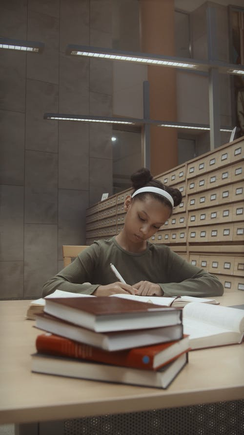 A Girl Researching in a Library