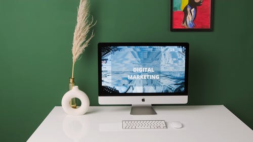 Computer With Digital Marketing Showing on Monitor
