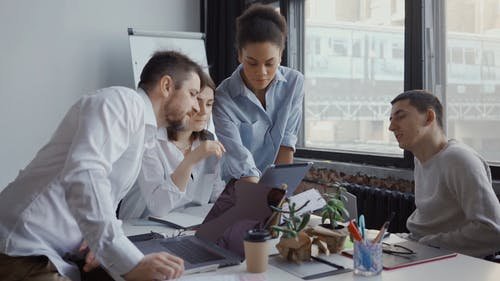 Office Team Using Digital Tablet