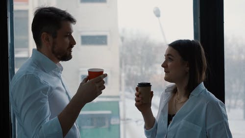 Corporate Colleague Talking while Drinking a Coffee