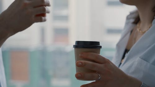 Close Up Video of People Holding a Cup