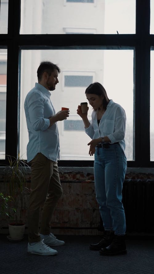 Man and Woman Chatting while Having Coffee