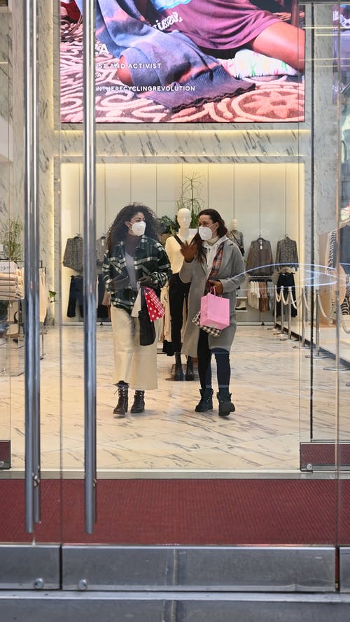 Women Walking Out of a Store