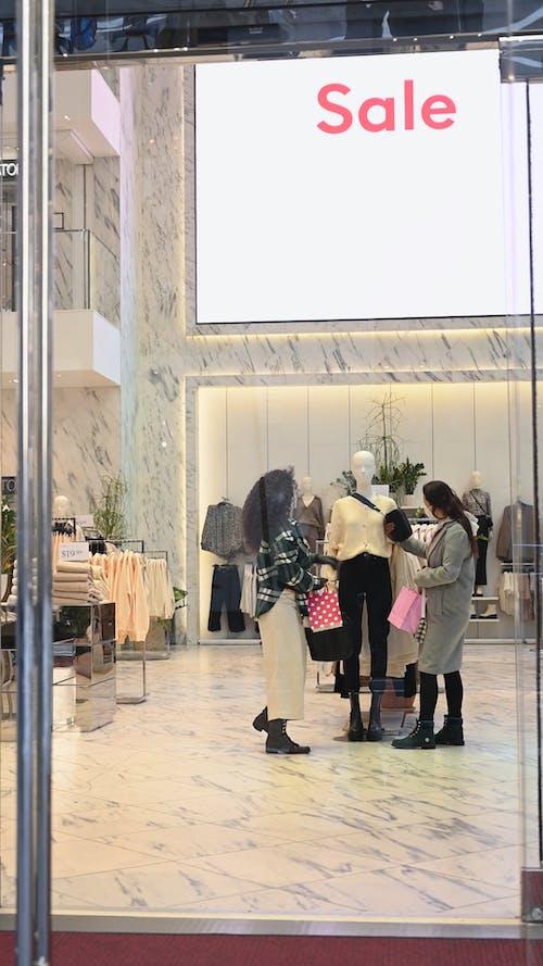 Two Women Inside a Boutique on Sale