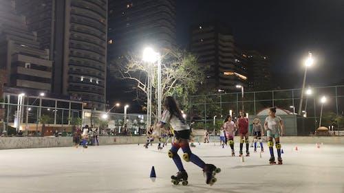 Girls Roller Skating at Night