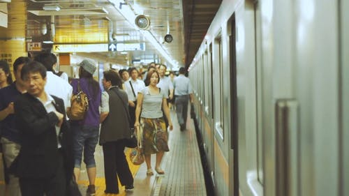 People Getting Ready to Board the Subway Train