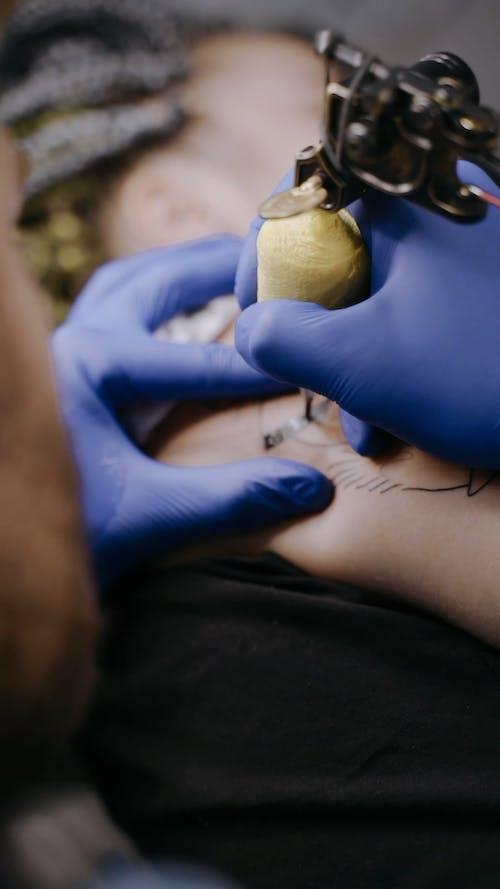 A Man Tattooing