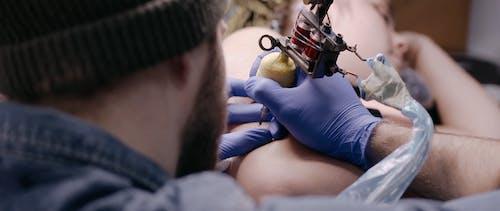 Man Doing Tattoo
