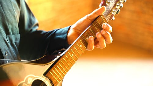 A Man Playing the Guitar