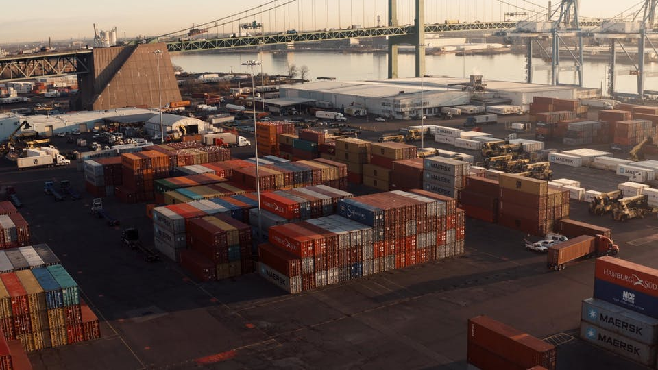 Aerial View Of Container Vans And Trucks In The Port