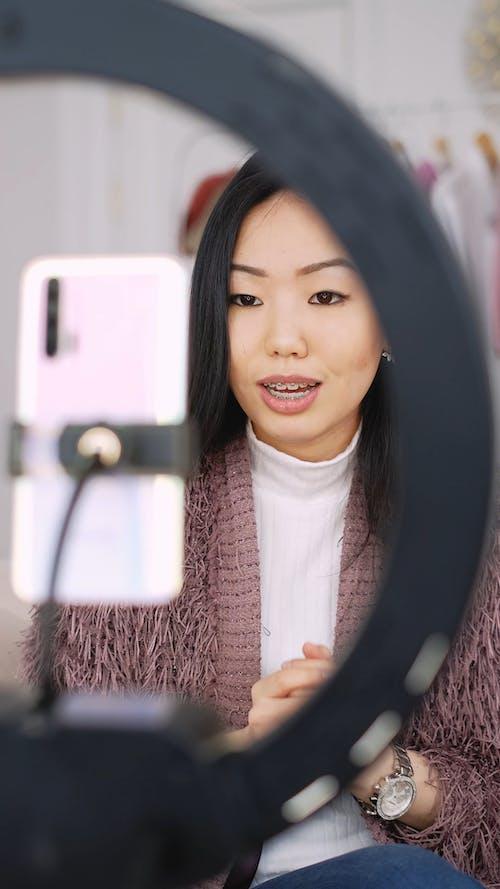 Woman Recording A Vlog