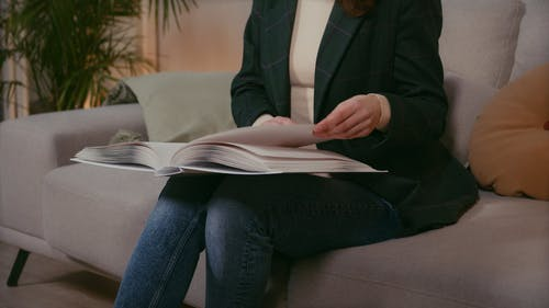 A Blind Woman Reading Using a Braille