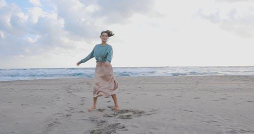 Woman Enjoying the Beach in Barefoot