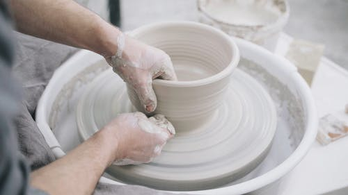 Man Sculpting Out Of Clay