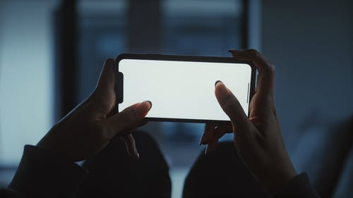 Person Holding a Smartphone
