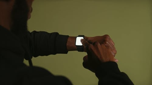 A Man Using His Smartwatch
