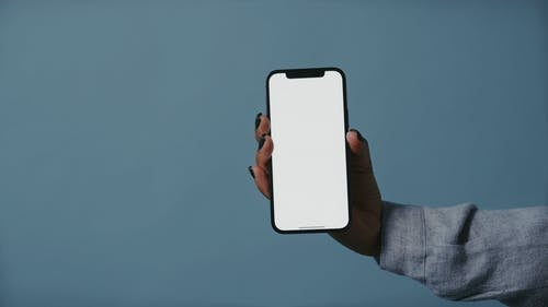 A Person Holding a Mobile Phone