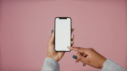 A Person Touching a Mobile Phone