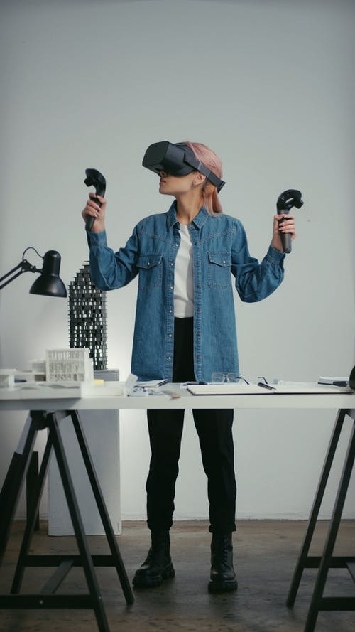 A Woman Playing Virtual Reality Game