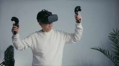 A Man Playing Virtual Reality Game