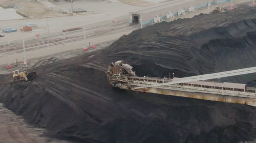 Aerial View of Heavy Equipment Working on the Sand