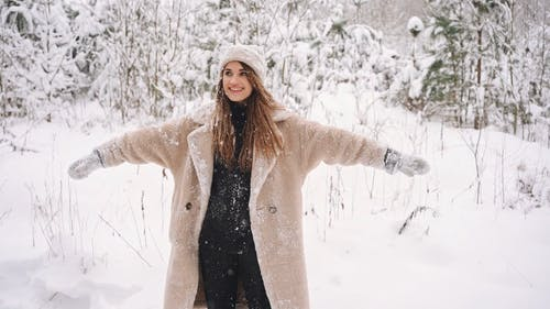 A Happy Woman Playing in Snow