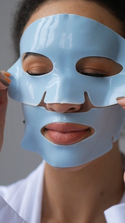 Young Woman Removing Facial Mask