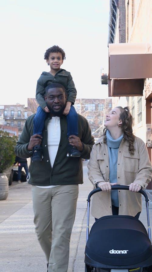 Happy Family Strolling on Street