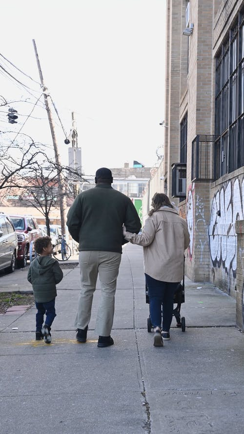 Father and Mother with Kids Strolling