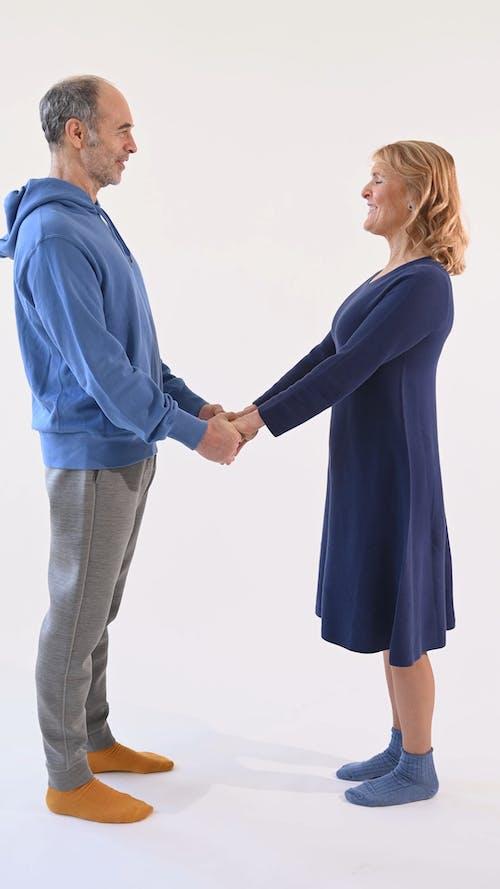 Elderly Couple Holding Hands Together