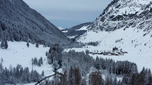 Drone Footage Of A Community Village Covered In Snow