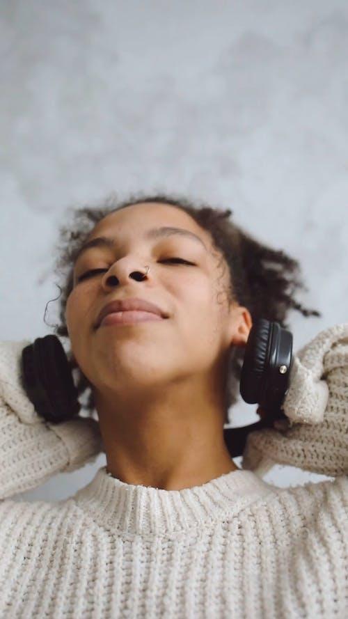 A Girl Wearing A Headphones