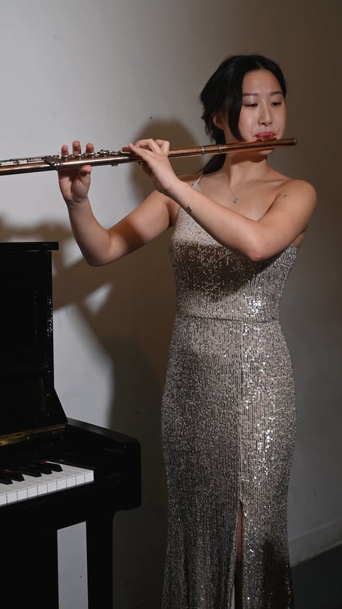 Woman Playing A Concert Flute
