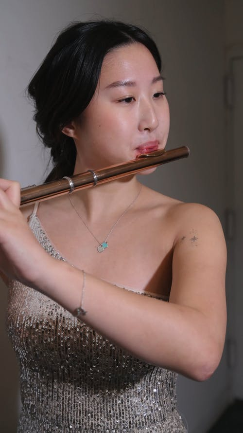 Woman Playing Flute