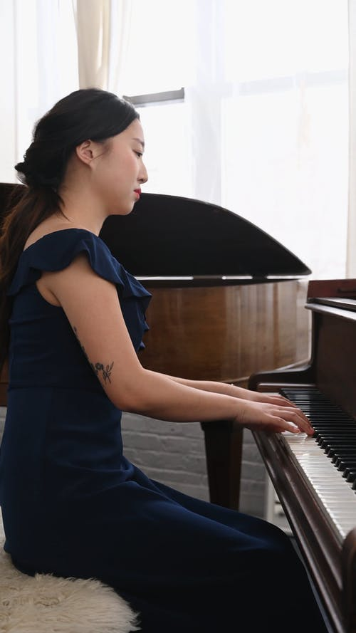 Side View Of Woman Playing Piano