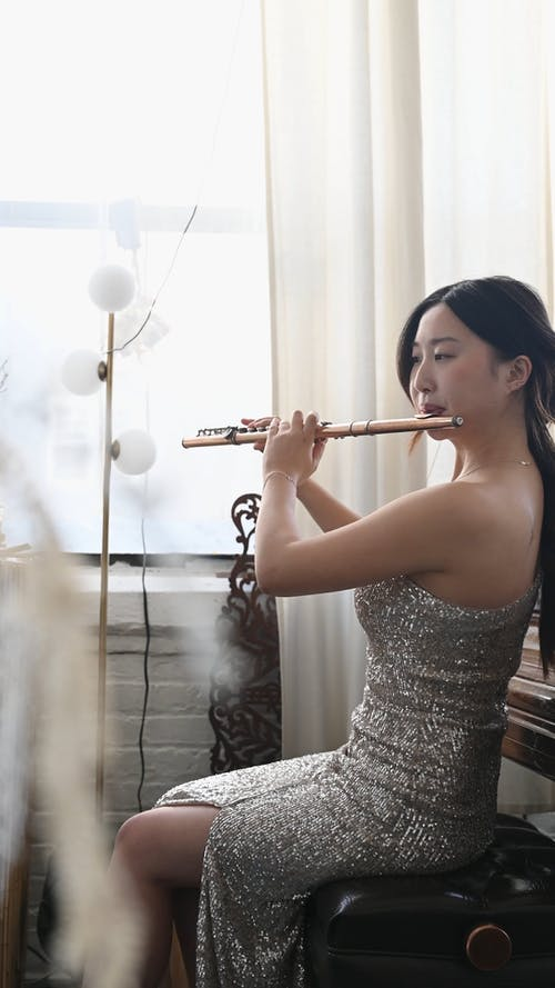 Woman Playing the Flute
