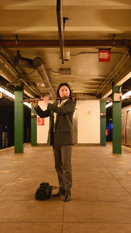 Woman Playing the Flute at the Subway