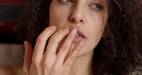A Close up of a Woman Touching her Lips