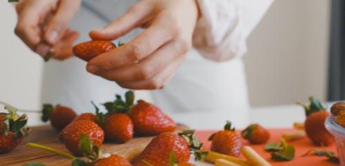 A Person Slicing a Strawberry