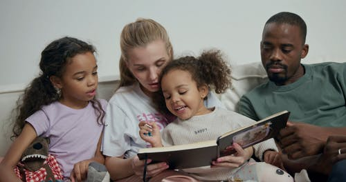 Dicerse Family Looking at Photos