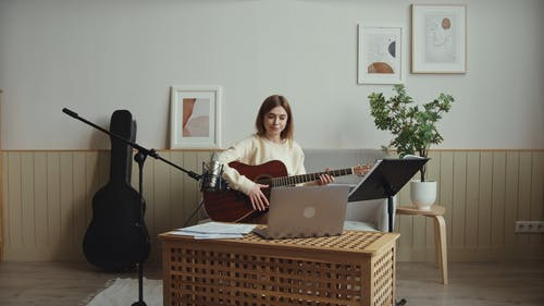 Young Woman Showing Her Guitar Skill Online