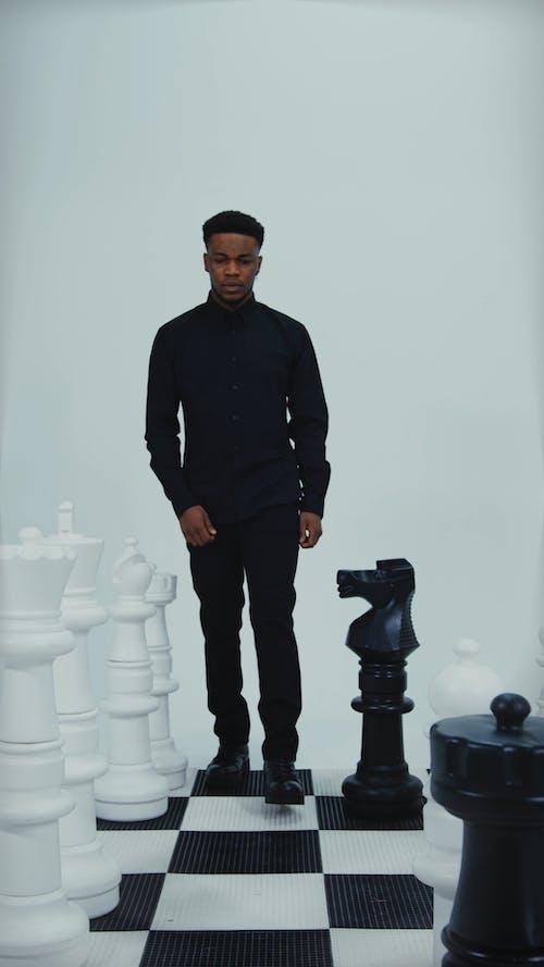 A Man Walking at the Checkerboard