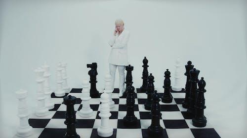A Woman Walking at the Checkerboard