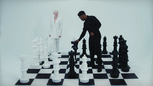 People Playing Giant Chess Game