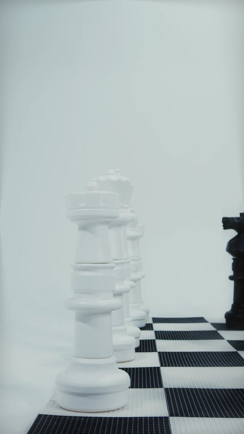 A Vertical Video of Life Size Chess Pieces