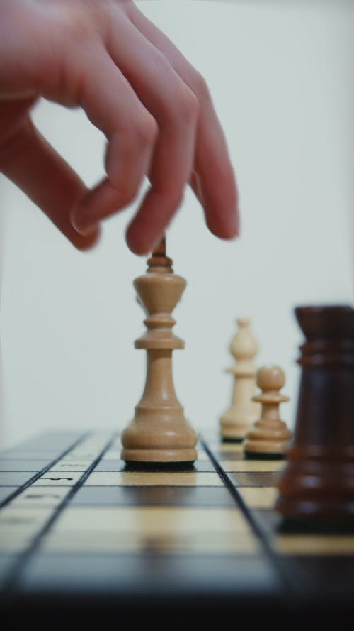 Side View of Hands Playing Chess