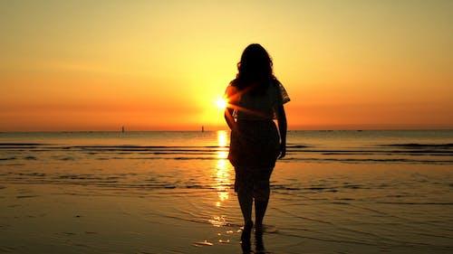Female Silhouette Entering the Sea